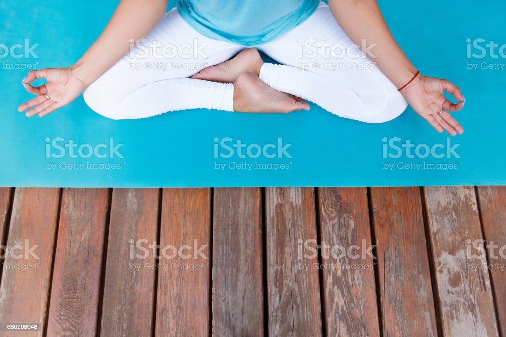 fitness woman working out on wooden floore terrace, doing yoga exercise stock photo