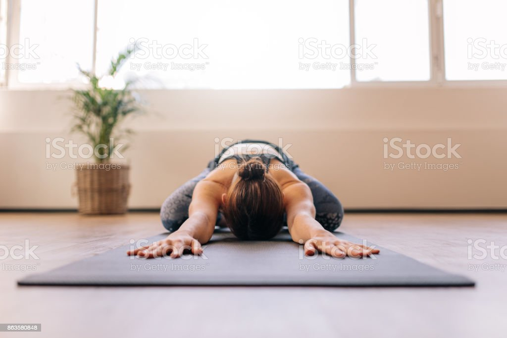 Fitness woman working out on yoga mat stock photo