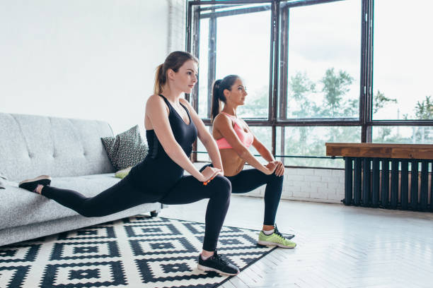 Fitness women doing front forward one leg step lunge exercises workout Fitness women doing front forward one leg step lunge exercises workout. lateral surface stock pictures, royalty-free photos & images