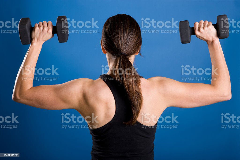 Fitness-Female Lifting Weights-Rear View stock photo