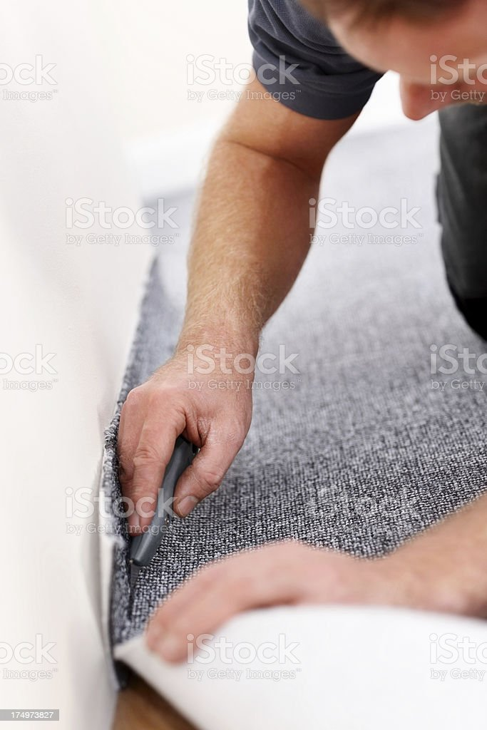 Fitter trimming floor carpet stock photo
