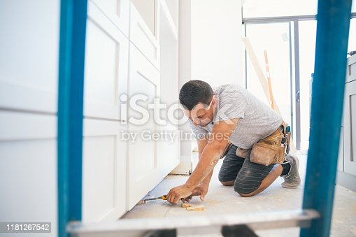 Installing a kitchen in a new house.