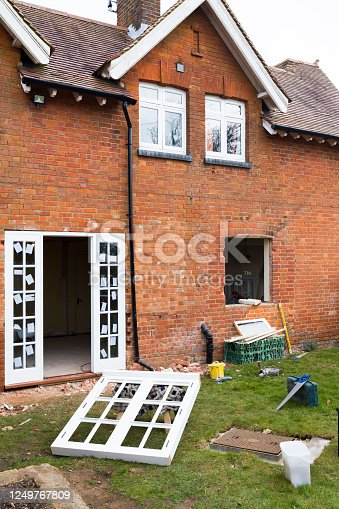 1070686034 istock photo Fitting installing replacement wooden windows UK 1249767809