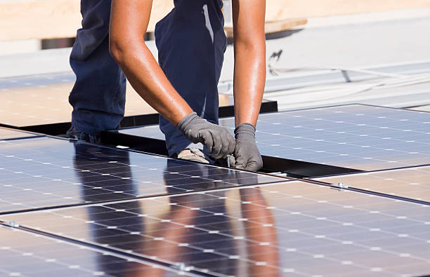 fitting photovoltaic panels stock photo