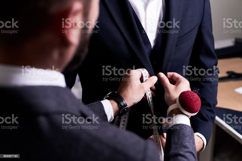 Fitting Suit to Model stock photo