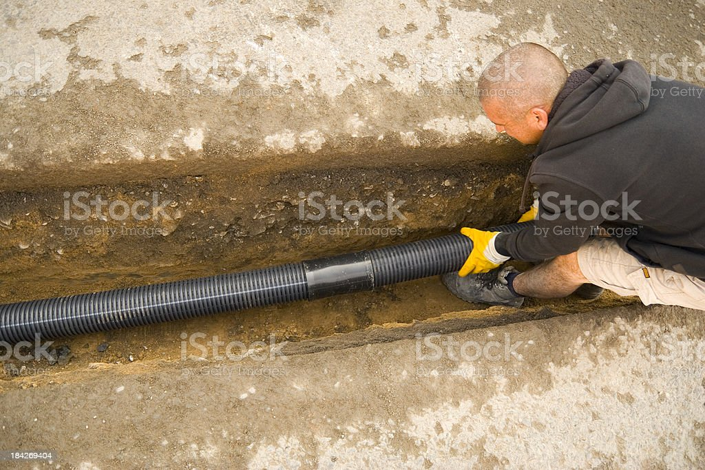 Fitting the Drain Pipes royalty-free stock photo