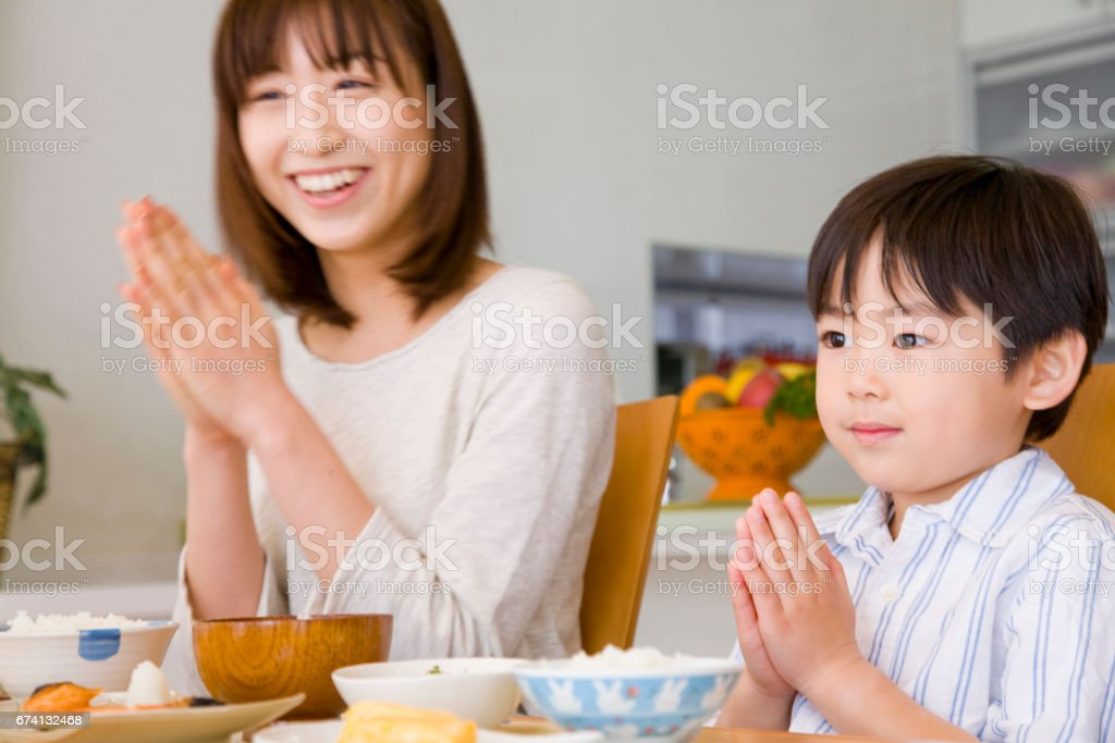 Fitting the hands ago eating MOM and son stock photo