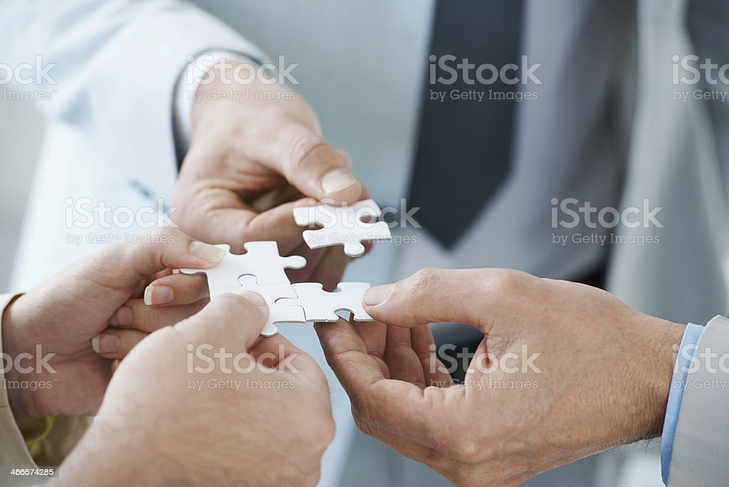 Fitting the pieces together stock photo