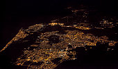 Fiumicino city near Rome, Italy. sea coast, view from airplane at night
