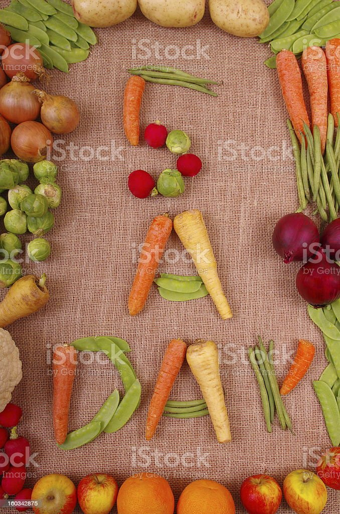 Fresh vegetables and fruit laid out to show the healthy eating...