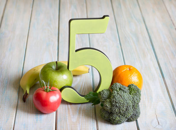 5 Five a day portion size with fresh fruits and vegetables healthy diet lifestyle concept stock photo
