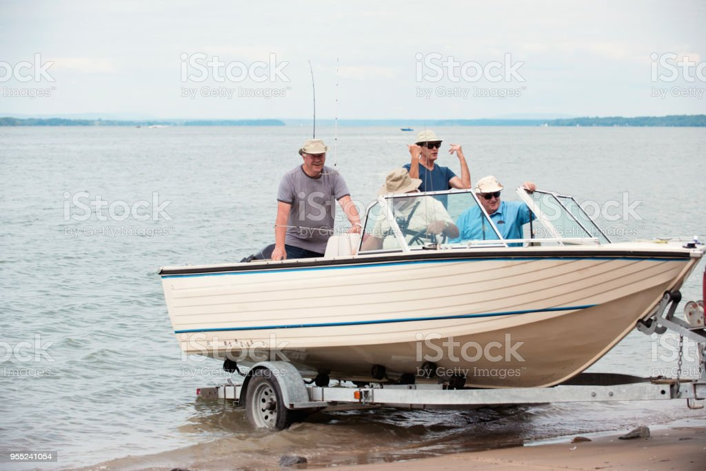 Five active seniors brothers on a fishing trip stock photo