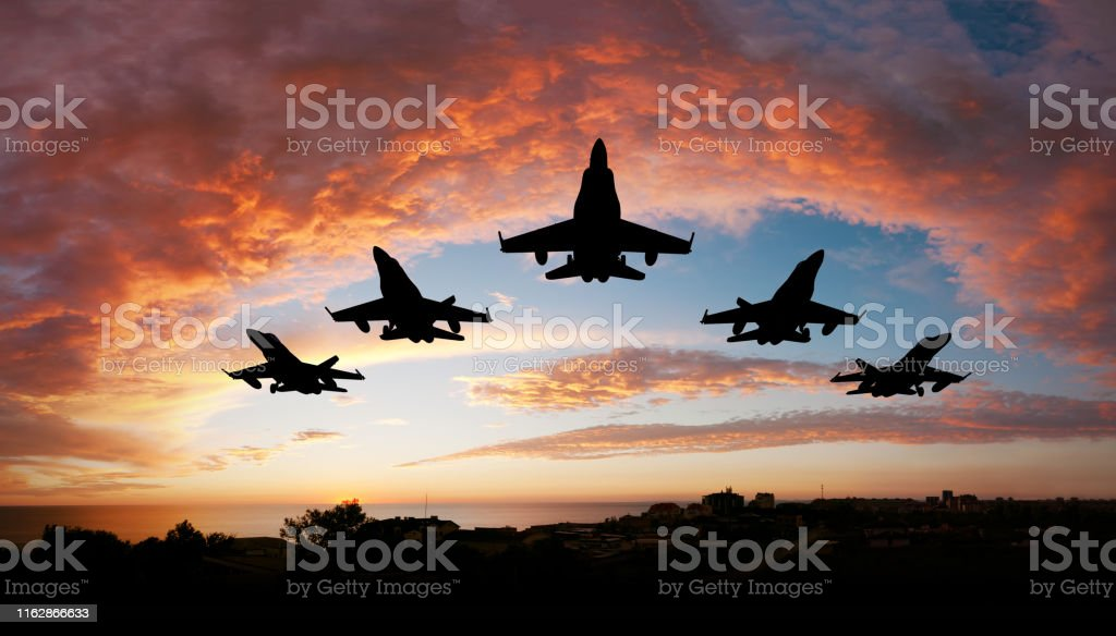 Five airplanes Five fighters flying at sunset Air Attack Stock Photo