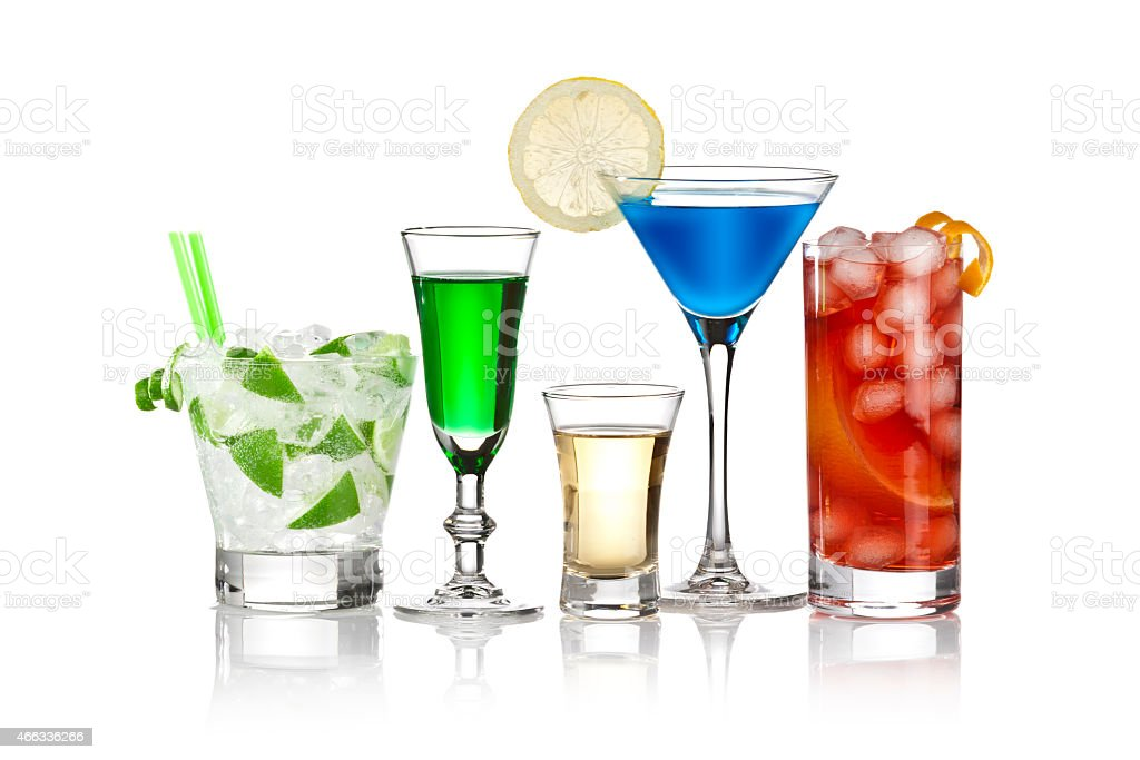 Five alcoholic drinks arranged in a row on white background stock photo