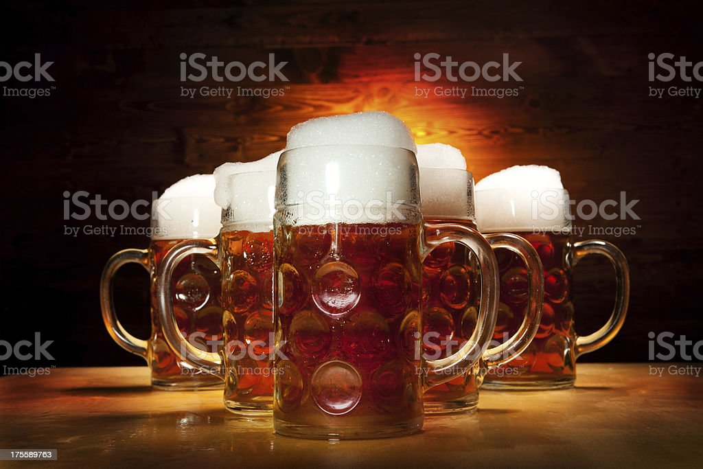 Five Beer Glasses on the Wooden Table stock photo