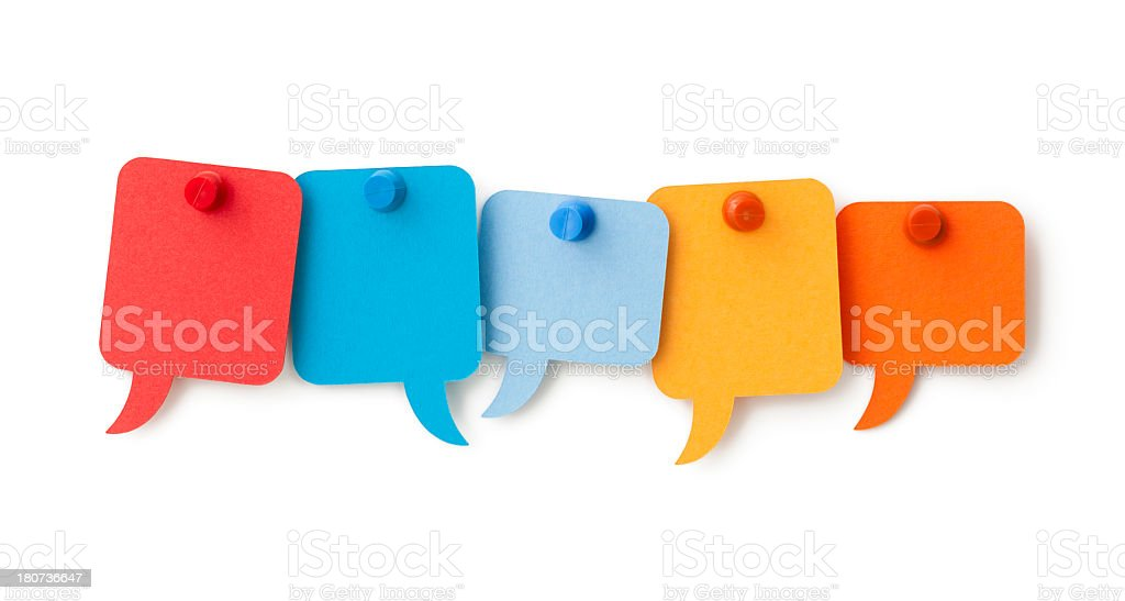 Five blank colourful speech bubbles pinned to a white surface stock photo