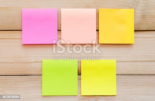 istock five blank sticky note or post note colorful yellow green and pink on wood table or wood board. 922929094