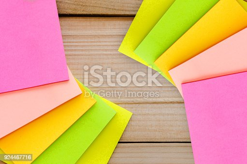 istock five blank sticky note or post note colorful yellow green and pink on wood table or wood board. 924467716