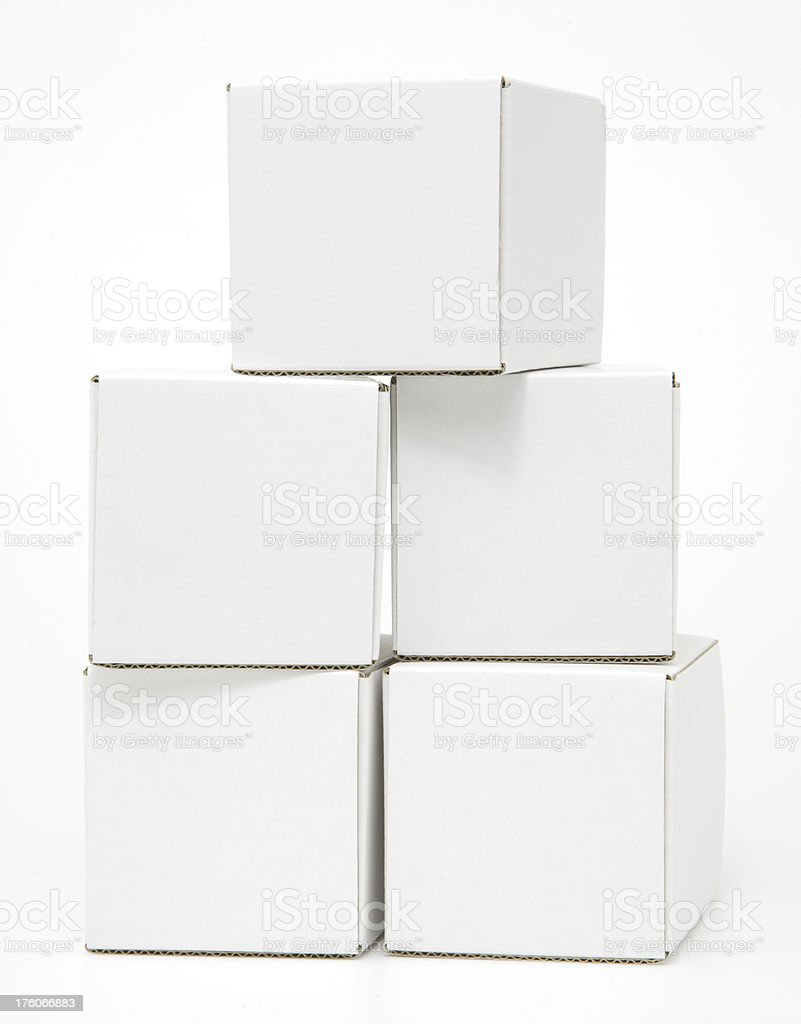Five blank white cardboard cartons casually stacked royalty-free stock photo