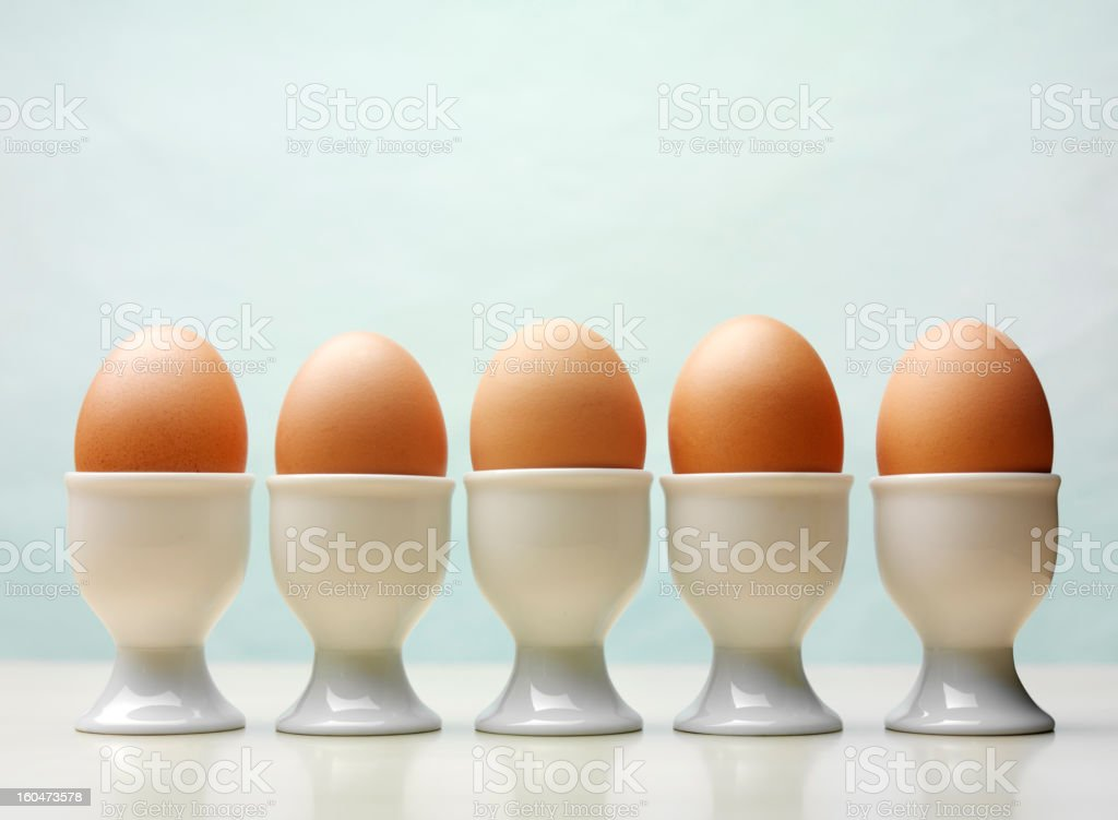 Five Boiled Eggs in Egg Cups stock photo