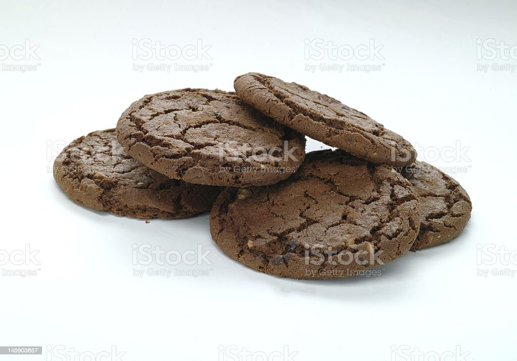 Five brown chocolate cookies on a white background royalty-free stock photo