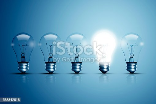 istock Five bulbs and one of them is glowing. 533342616