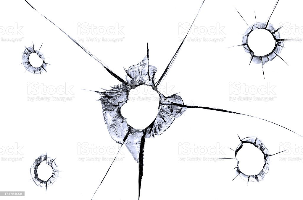 Five bullet holes in glass window stock photo