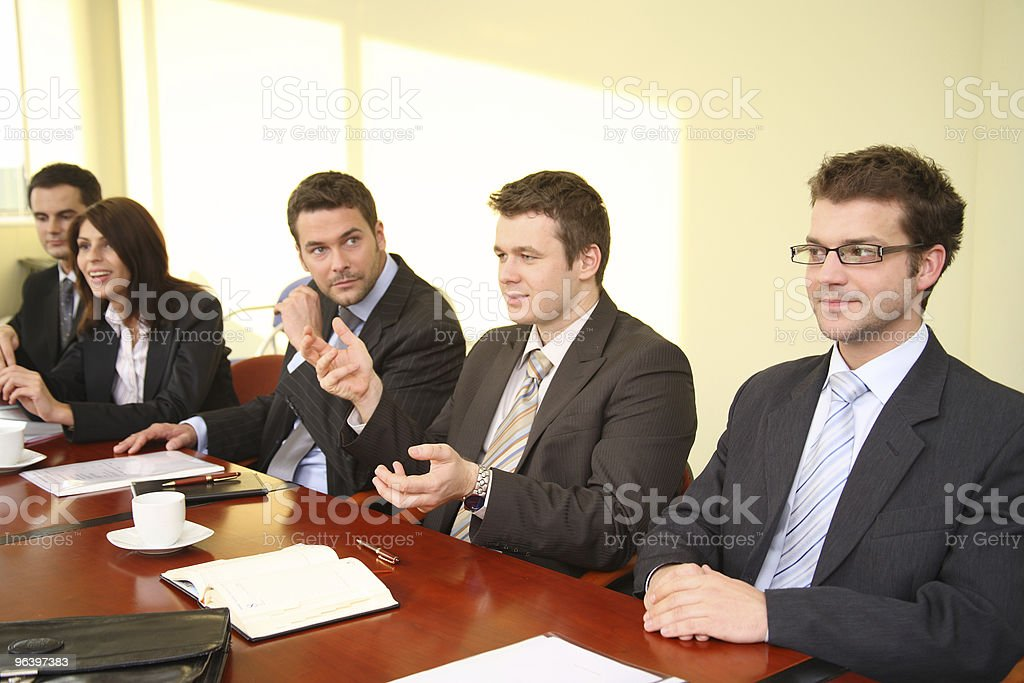five business people at the debate stock photo