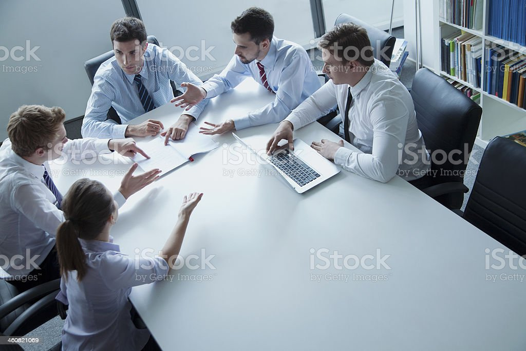 Five business people having a meeting stock photo