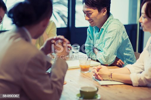 istock Five business people meeting in a cafe 584890062
