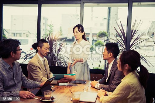 istock Five business people meeting in a cafe 584891190