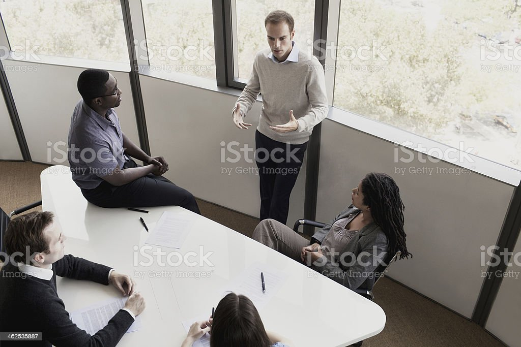 Five Business People Sitting At A Conference Table Stock Photo - 20 person conference table