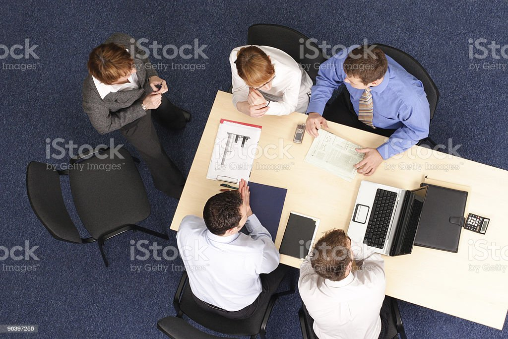 Five businesspeople brainstorming at table - Royalty-free Administrator Stock Photo