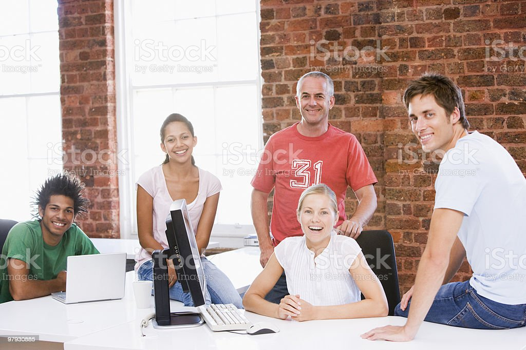 Five businesspeople in office space royalty-free stock photo