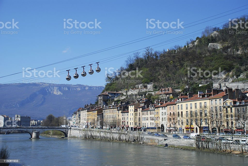 Five cable cars traveling up a mountain in Grenoble stock photo