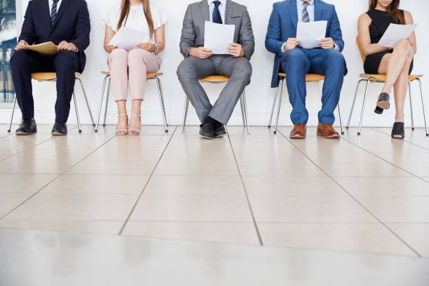 Five candidates waiting for job interviews, front view, crop stock photo