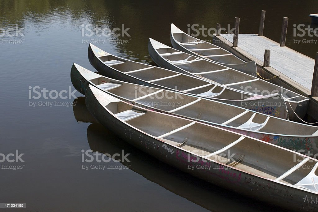 Five canoes on the water royalty-free stock photo