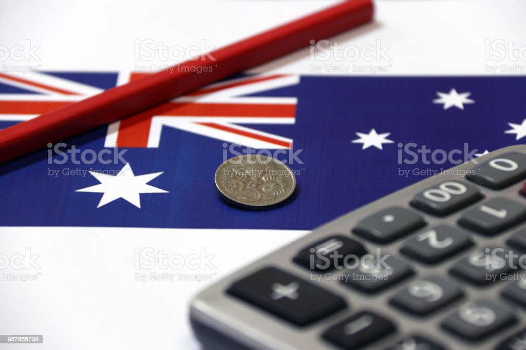 Five Cents Coin Of Australia On The Blue Color Of Australian Nation Flag With Red Pencil