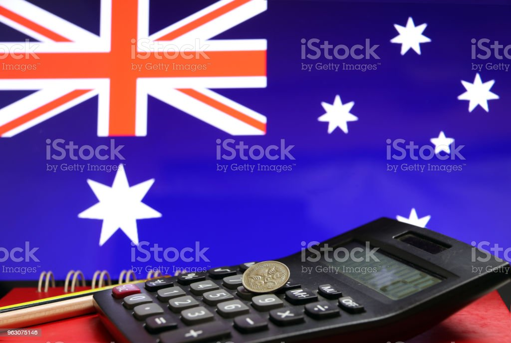 Five Cents Coin Of Australia On The Calculator With Pencils On The Red Floor And Blue Color Of Australian Nation Flag Background Stock Image