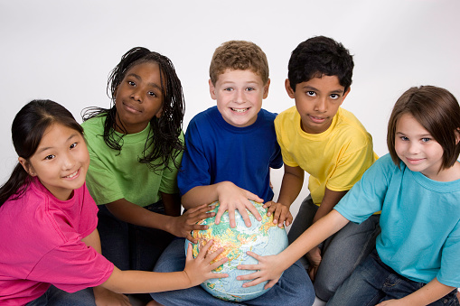 Five Children Of Different Ethnicities With Hands On A ...