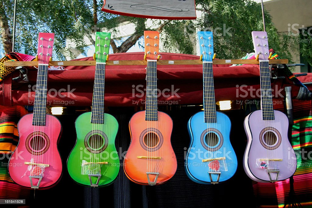 Five colorful guitars in a row stock photo