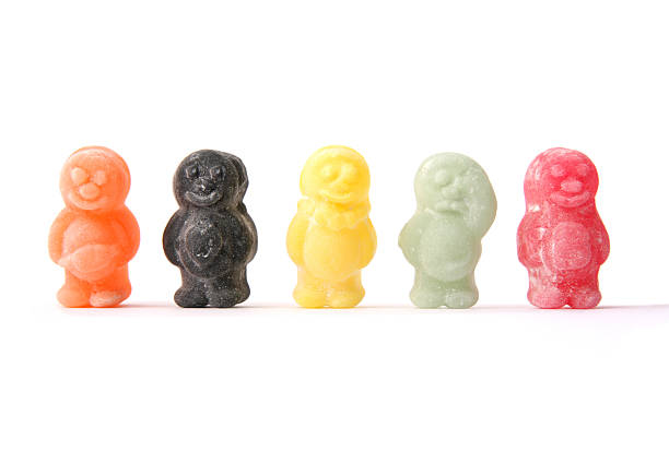 Five colorful jelly babies on a white background Jelly Babies in a row gelatin stock pictures, royalty-free photos & images