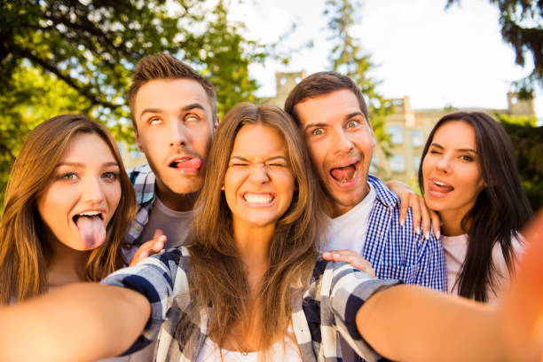 five crazy best friends fooling  and making funny selfie photo - beautiful college girl pics stock photos and pictures