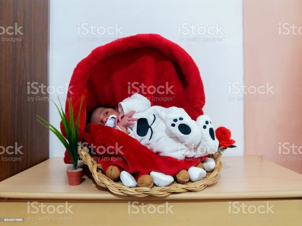 five days old baby boy sleeping in the basket stock photo