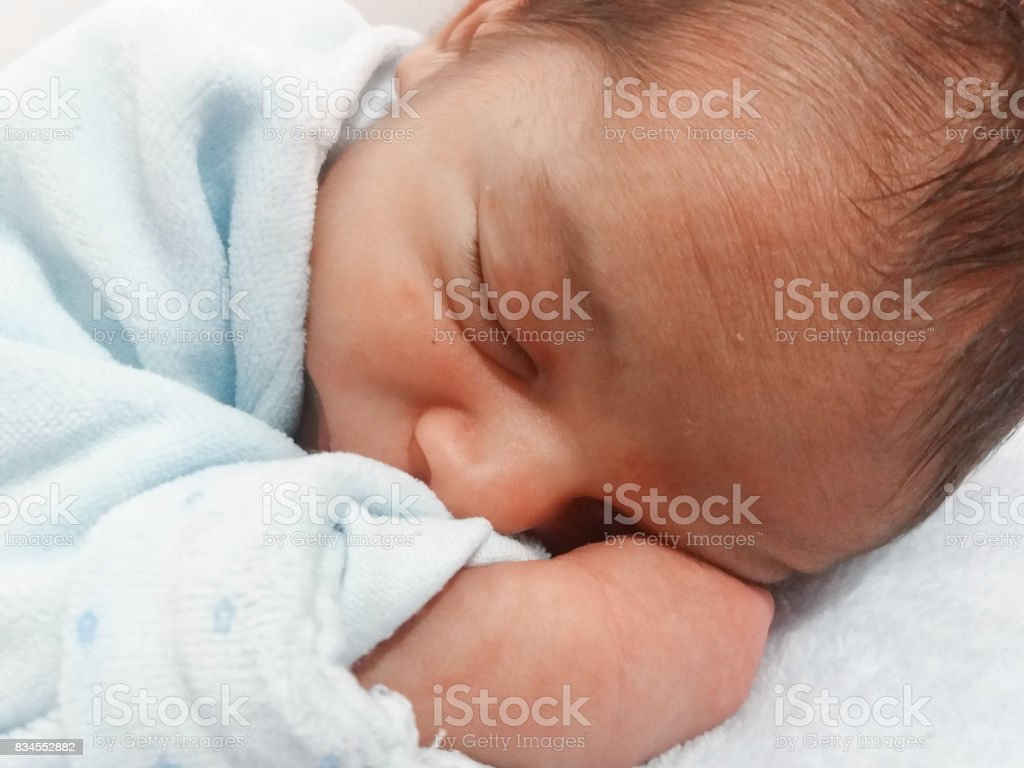 five days old baby boy sleeping stock photo