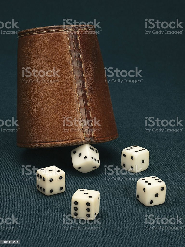 Five dice and leather cup stock photo