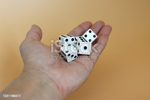 istock Five dice on the palm. 1031196372