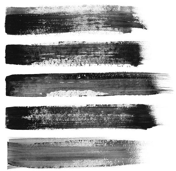 Five different black paint brush strokes on white foto