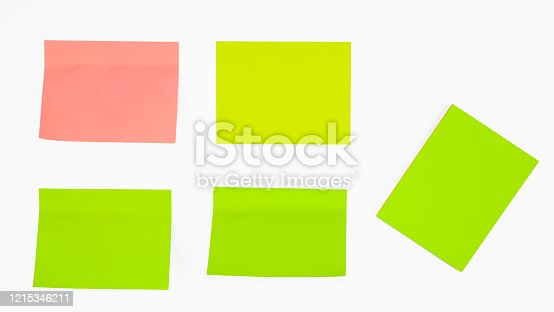 1090161334 istock photo Five different colored paper sticky notes displayed before an isolated white background 1215346211