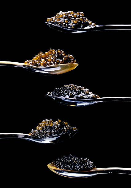 cinco tipos diferentes de caviar en negro - caviar fotografías e imágenes de stock